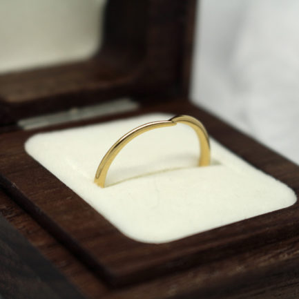 Recycled yellow gold wedding ring shaped to fit engagement ring Ethical gold wishbone wedding ring by Julie Nicaisse - Jewellery Designer in London