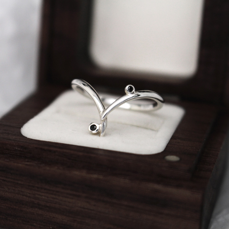 Fairtrade white gold and black diamond wishbone ring by Julie Nicaisse - Jewellery Designer in London