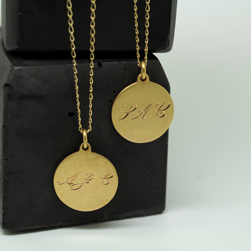 gold medal with engraved initials by Julie Nicaisse Jewellery designer in London