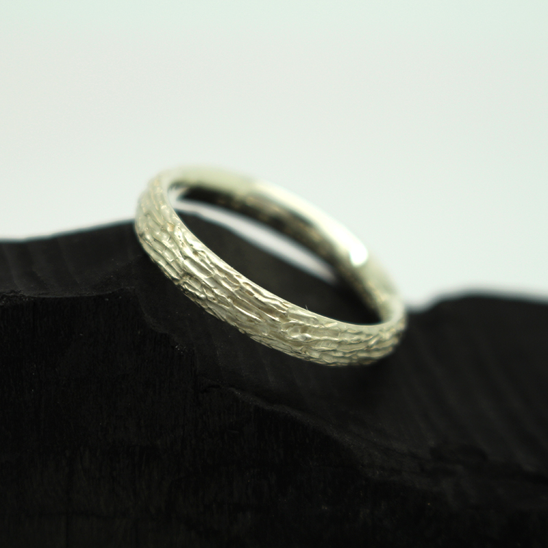 Handmade white gold men ring with textures and engraving by Julie Nicaisse Jewellery Designer in London